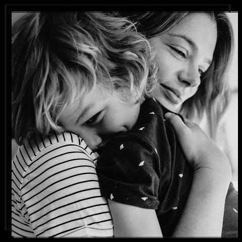 boy hugging mum