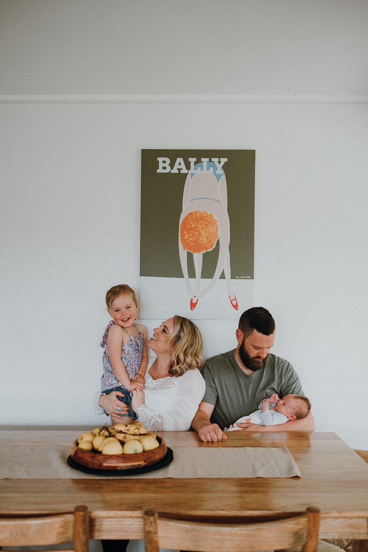 family sitting on kitchen bench