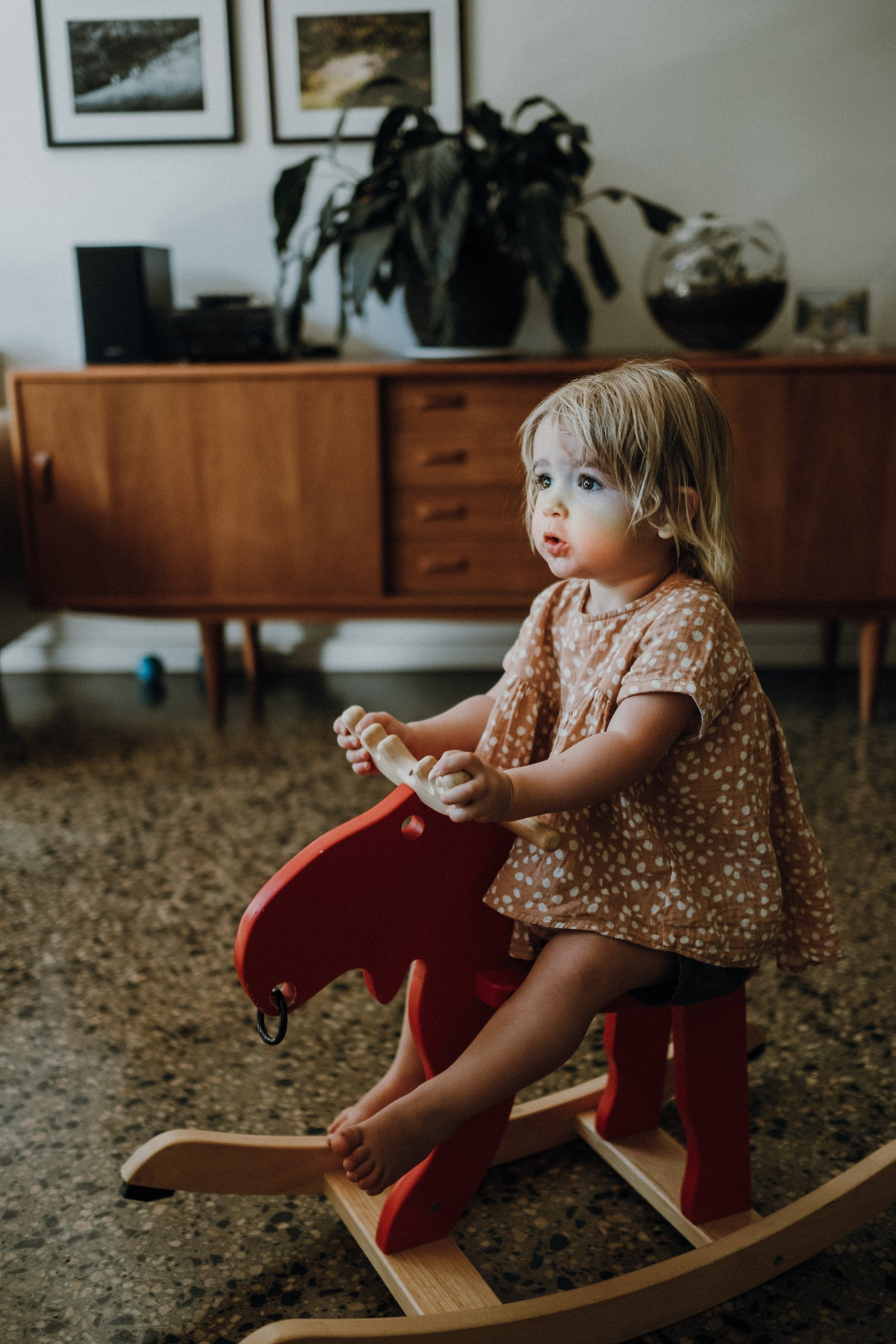 child-on-rocking-horse