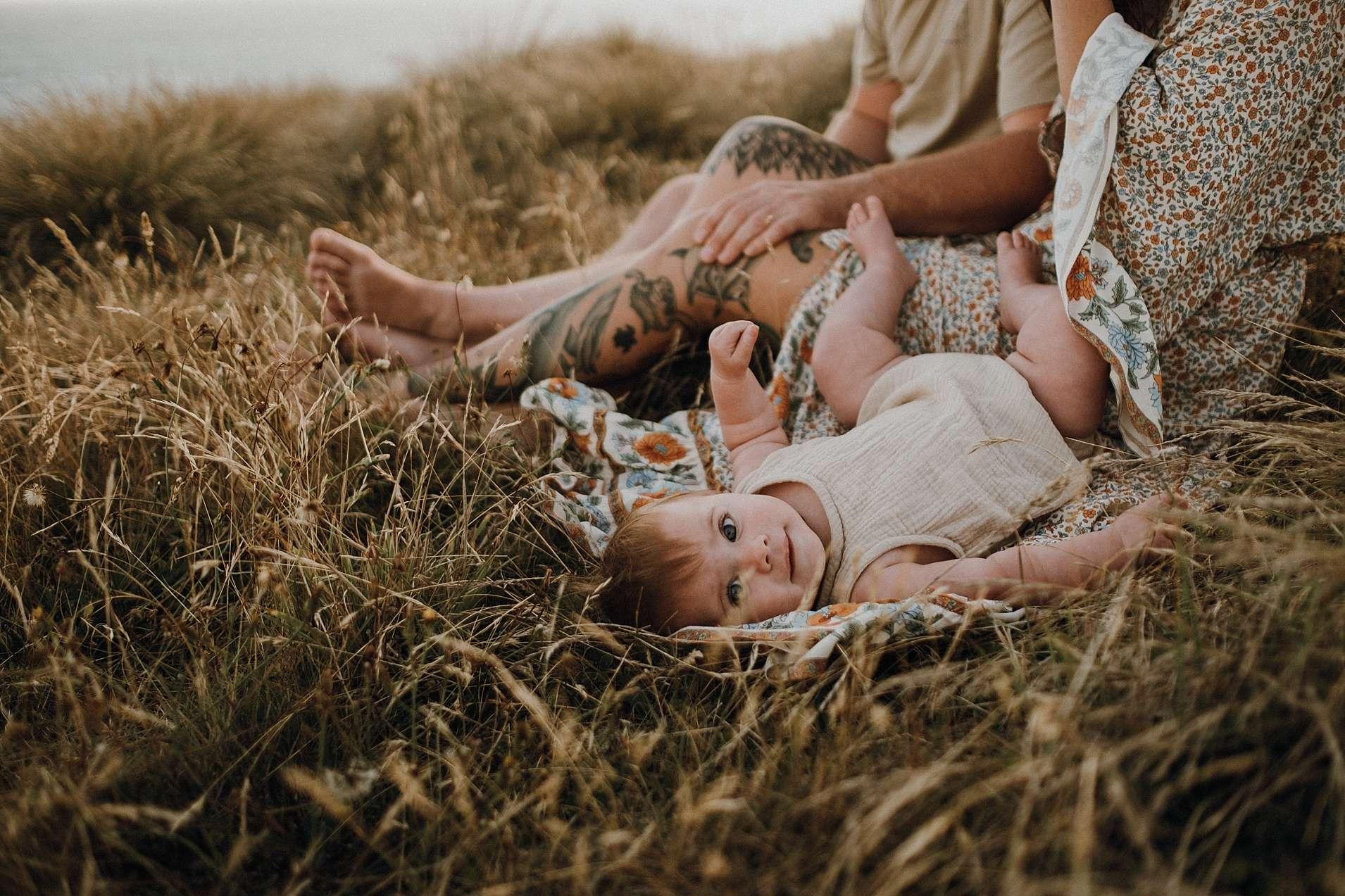 Baby-girl-lying-in-grass