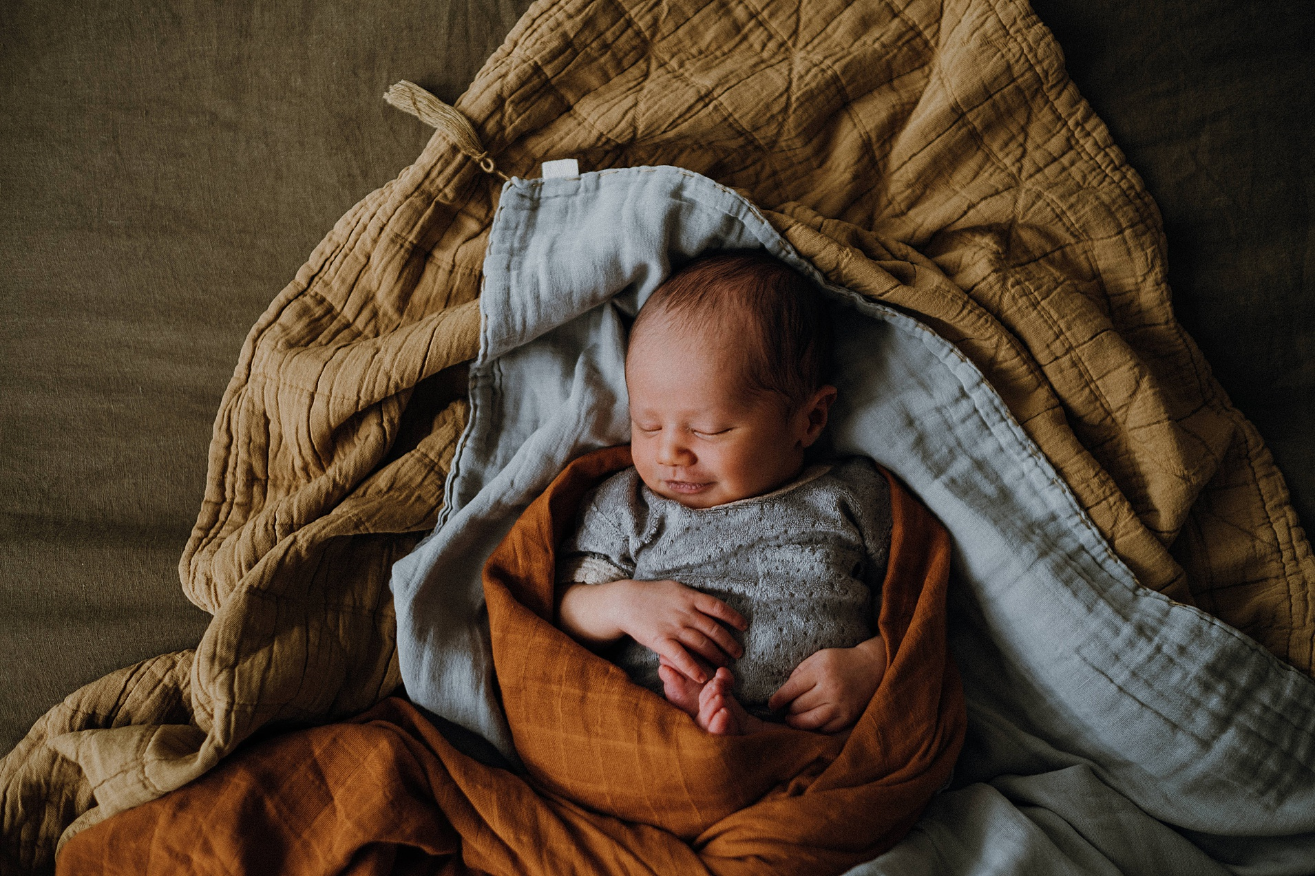 newborn-portrait-on-bed